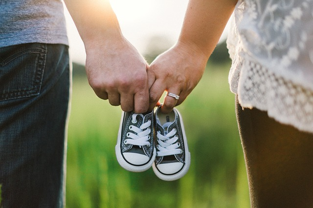 couple holding shoes